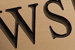 Compare Brass Signs